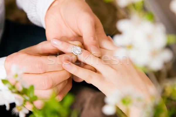 Man promising wedding to woman Stock photo © Kzenon