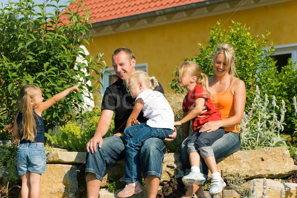Family in front of home Stock photo © Kzenon