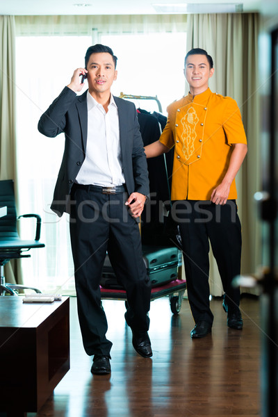 Asian Guest checking in hotel room Stock photo © Kzenon