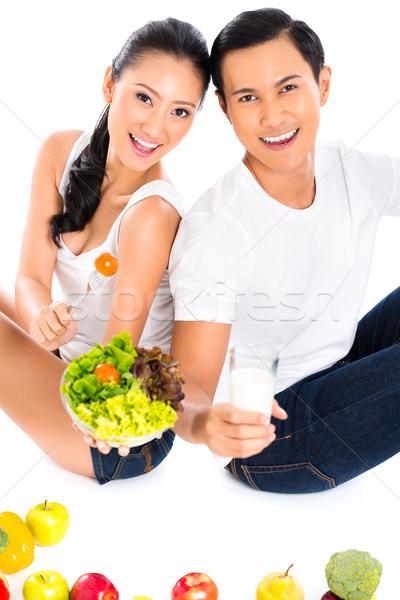 Asian couple eating salad fruit and vegetables Stock photo © Kzenon