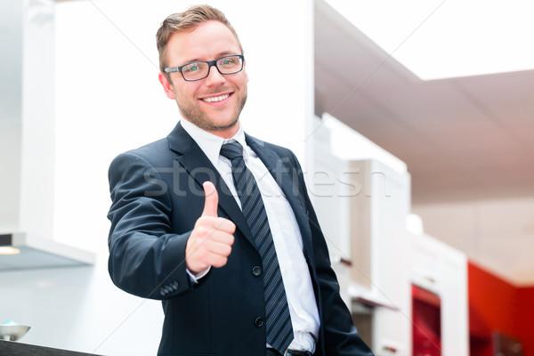 Salesman for domestic kitchen furniture store Stock photo © Kzenon