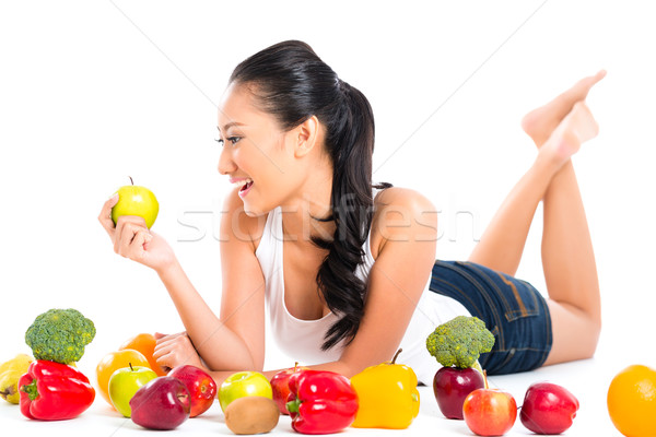 Asian chinese vrouw eten vers fruit fitness Stockfoto © Kzenon