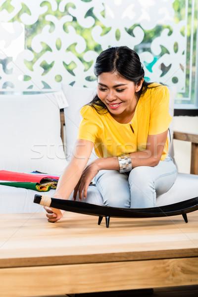 Asian kobieta sofa kanapie meble sklepu Zdjęcia stock © Kzenon