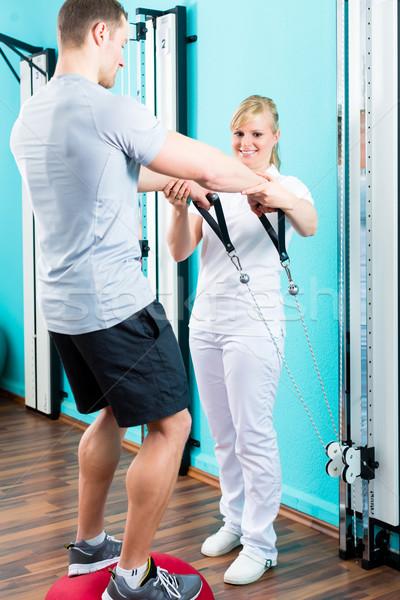 Physiotherapist excercising patient in practice  Stock photo © Kzenon