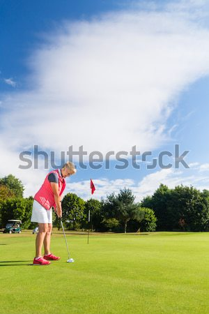 Senior golf playing man putting on green Stock photo © Kzenon