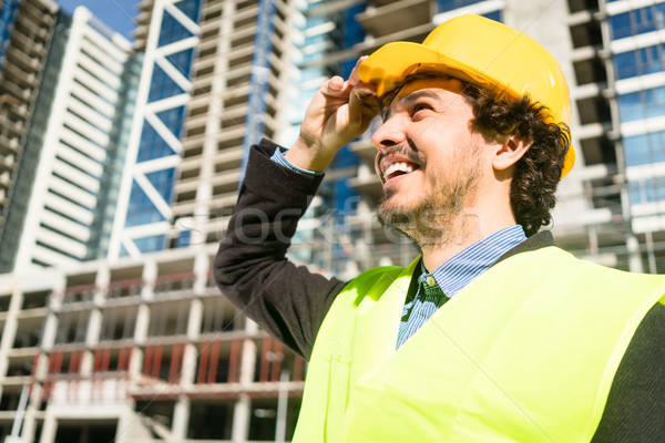 Civil engineer checks progress of construction works at building Stock photo © Kzenon
