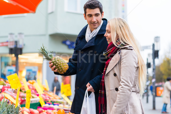 Couple buying groceries on farmers market stand Stock photo © Kzenon