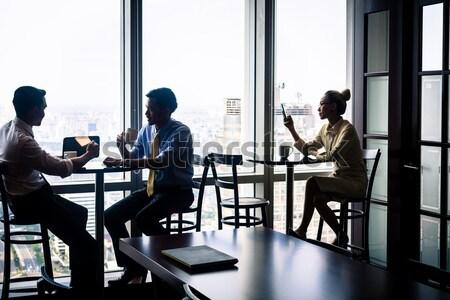 Imprenditrici riunione edificio per uffici asian guardando Foto d'archivio © Kzenon