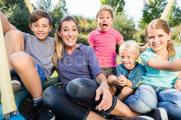 Family with mom, sons and daughters taking photo together  Stock photo © Kzenon