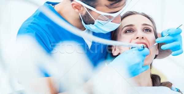 Belle jeune femme dentaires Photo stock © Kzenon