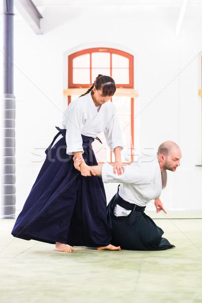 Man vrouw vechten aikido vechtsporten school Stockfoto © Kzenon