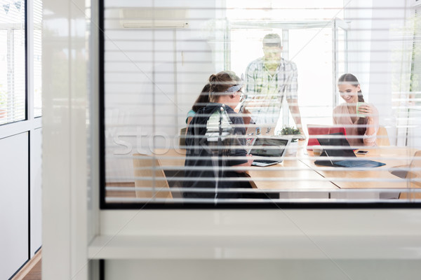 Close-up of the interior window of a modern work hub with shared offices Stock photo © Kzenon