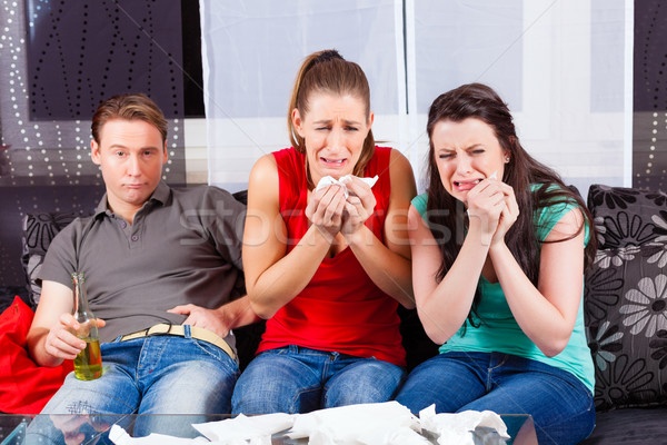 Friends watching a sad movie in TV Stock photo © Kzenon