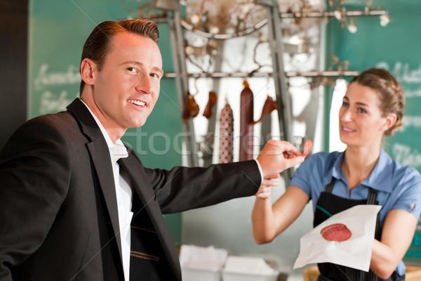 Smiling Male Executive Holding Meat With Butcher Stock photo © Kzenon