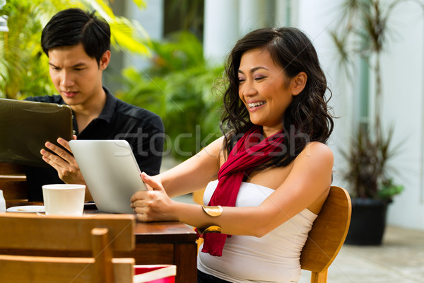 Asian people in cafe with computer Stock photo © Kzenon