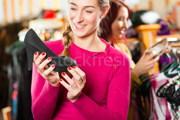 Woman is buying shoes for her Tracht or dirndl in a shop Stock photo © Kzenon