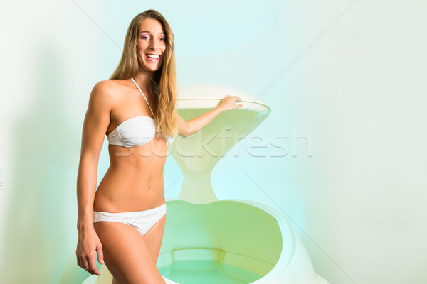 Wellness - young woman floating in Spa in bathtub Stock photo © Kzenon
