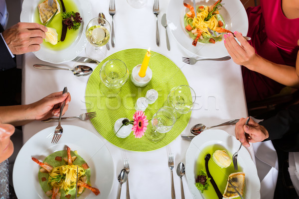 Two couples fine dining in restaurant Stock photo © Kzenon