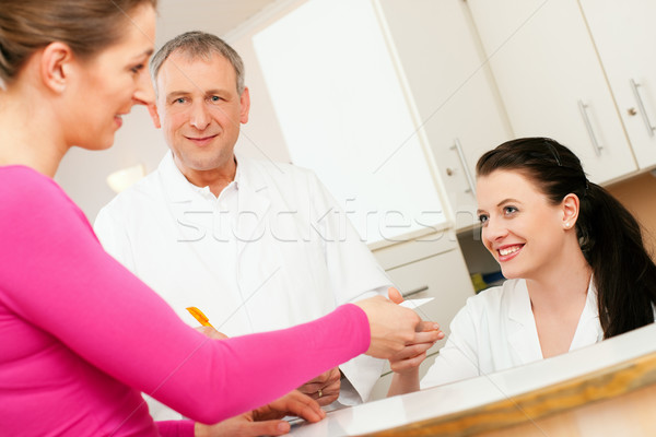 Woman at reception of clinic Stock photo © Kzenon