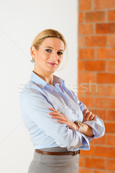 Realtor standing in empty apartment Stock photo © Kzenon