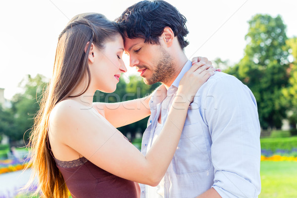 Tourist couple in city park hugging in love Stock photo © Kzenon