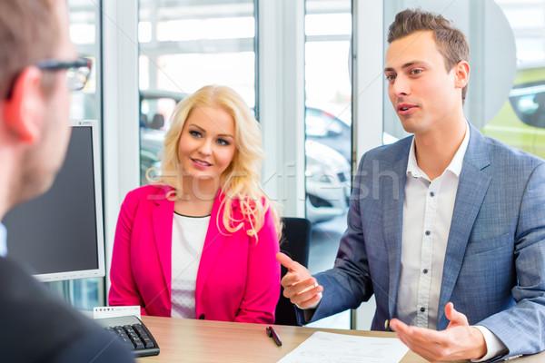 Couple negotiating sale contact for car  Stock photo © Kzenon