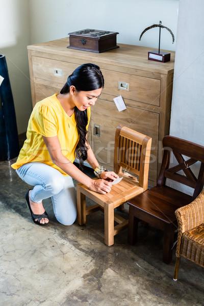 Asian woman in furniture store buying chair Stock photo © Kzenon