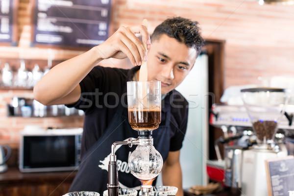 Barista preparing drip coffee in Asian coffee shop Stock photo © Kzenon