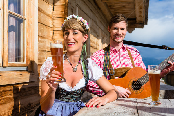 Couple on mountain hut making guitar music Stock photo © Kzenon