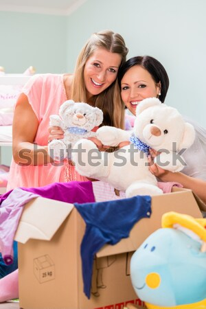 Pregnant woman with friend in prospective baby room Stock photo © Kzenon