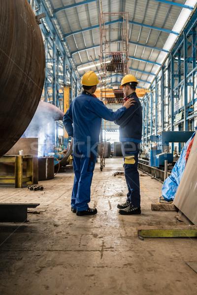Kettő munkások visel citromsárga védősisak kék Stock fotó © Kzenon