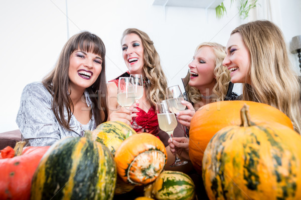 Beautiful woman posing funny while toasting with her friends dur Stock photo © Kzenon