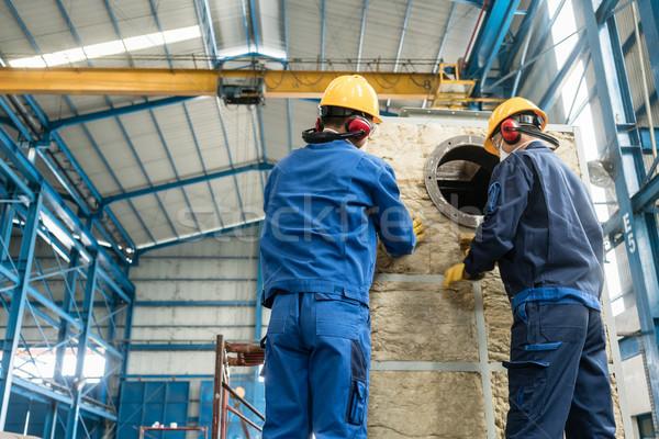 Işçiler yalıtım malzeme endüstriyel iki Stok fotoğraf © Kzenon