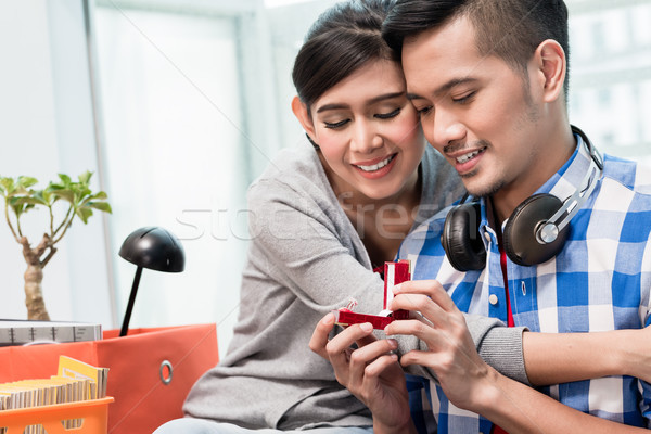 Young Indonesian man makes proposal to girlfriend  Stock photo © Kzenon
