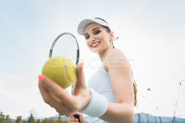 Woman wanting to play Tennis Stock photo © Kzenon
