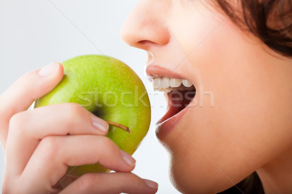 Young woman bites in a fresh and healthy apple Stock photo © Kzenon