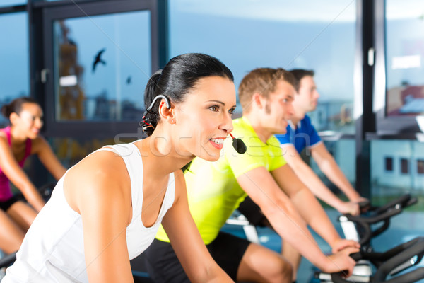 Young People Spinning in the fitness gym Stock photo © Kzenon