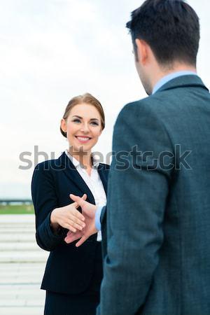 People welcoming with business handshake Stock photo © Kzenon