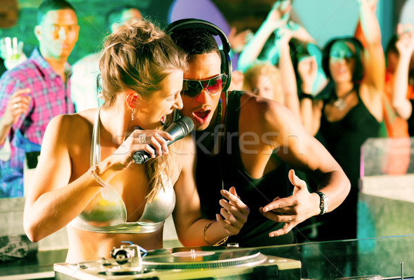 Stock photo: Two DJs at the turntable in club