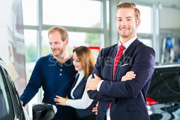 Dealer, clients and auto in car dealership Stock photo © Kzenon