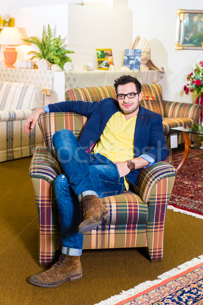 Man buying armchair in furniture store Stock photo © Kzenon