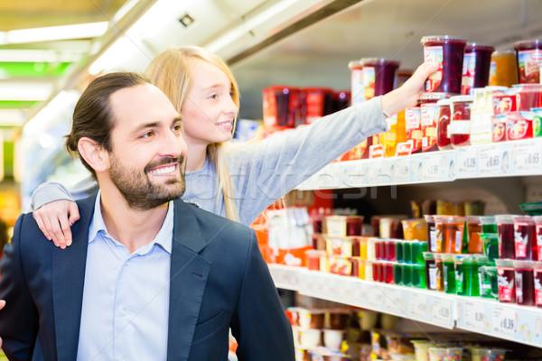 Family buying dessert in hypermarket Stock photo © Kzenon