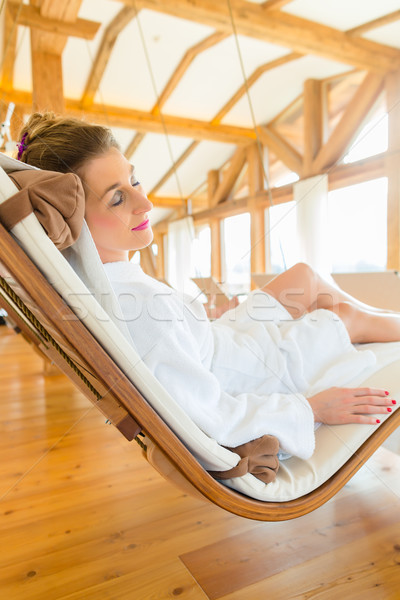Woman relaxing on wellness spa lounger Stock photo © Kzenon