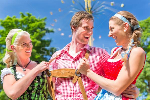 Friends visiting Bavarian folk festival Stock photo © Kzenon