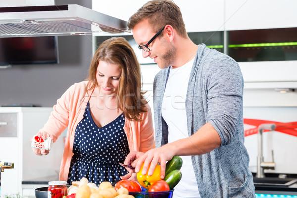 Couple cooking pasta in domestic kitchen Stock photo © Kzenon