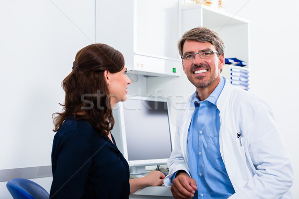 General practitioner in doctors office seeing patient Stock photo © Kzenon