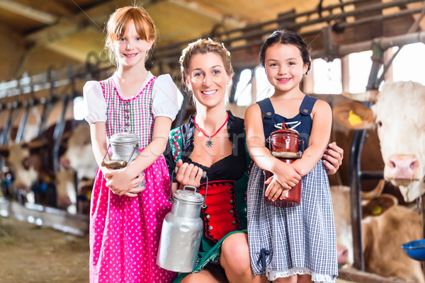 Bavarian family with milk can on cow farm Stock photo © Kzenon