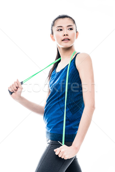 Fit young Asian woman with a skipping rope Stock photo © Kzenon