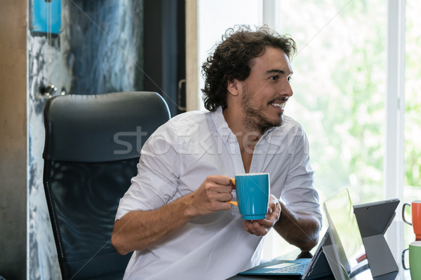 Employee in creative industries having coffee and talk Stock photo © Kzenon