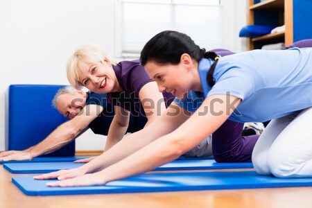 Physio doing kinesitherapy with senior patients  Stock photo © Kzenon